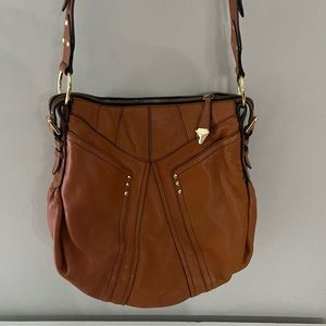 orYany cognac colored hobo bag with gold studs